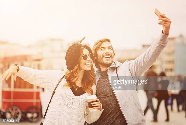 Happy People making selfie on the street