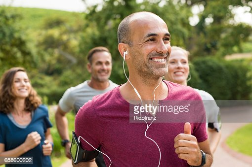 Happy people running : Stock Photo