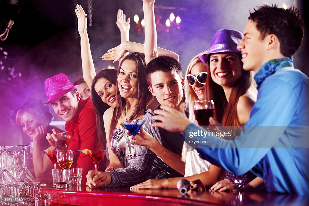 Happy people toasting with cocktails in a bar. : Stock Photo