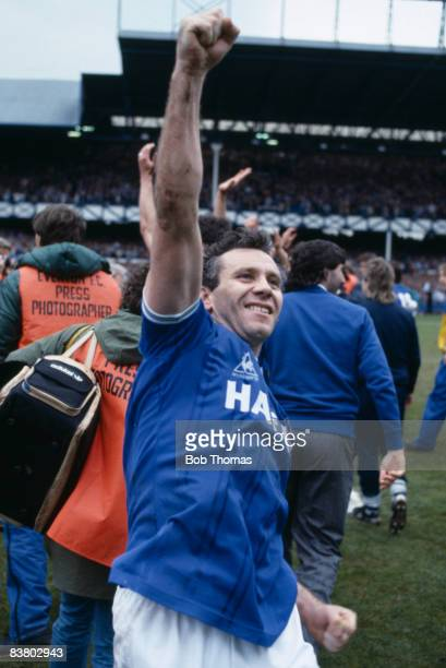 A happy Peter Reid celebrates after Everton's 20 victory over Queens Park Rangers had clinched the League Championship 6th May 1985