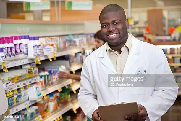 Happy pharmacist in the medicine aisle