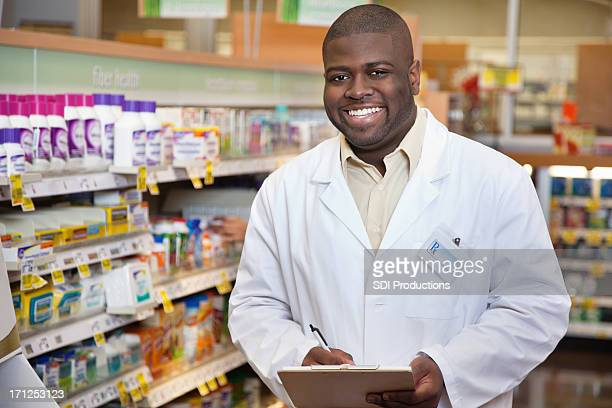 Happy pharmacist in the pharmacy aisle