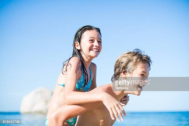 Happy piggyback on a beautiful summer day.