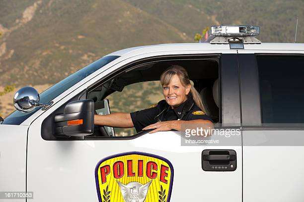 Happy Police Officer Driving Vehicle