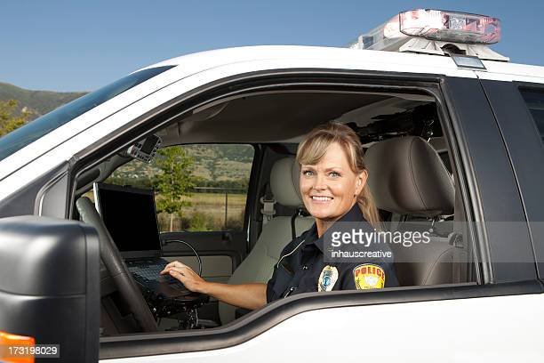 Happy Policewoman Driving Police Car on computer