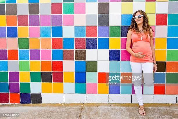 Happy Pregnant Woman in Bright Colors
