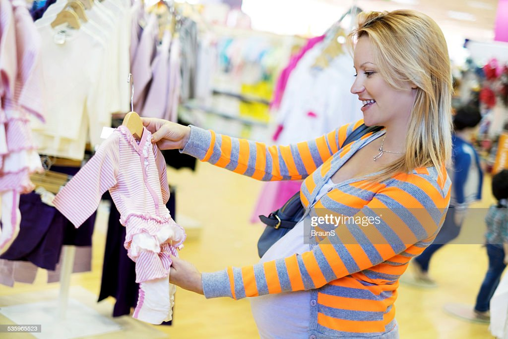 Happy pregnant woman in shopping. : Stock Photo