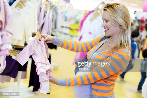 Happy pregnant woman in shopping.