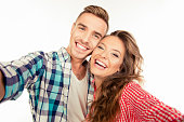 Happy pretty couple in love making selfie