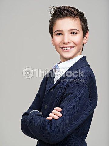 Happy pretty teenage boy posing at studio : Stock Photo