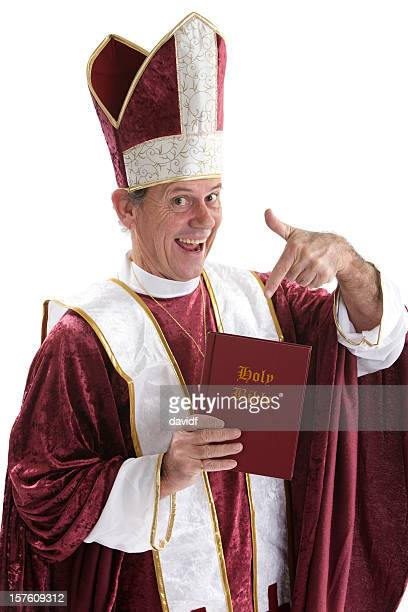 Happy Priest Pointing to a Bible