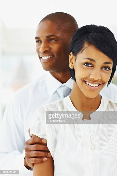 Happy professional African American couple smiling