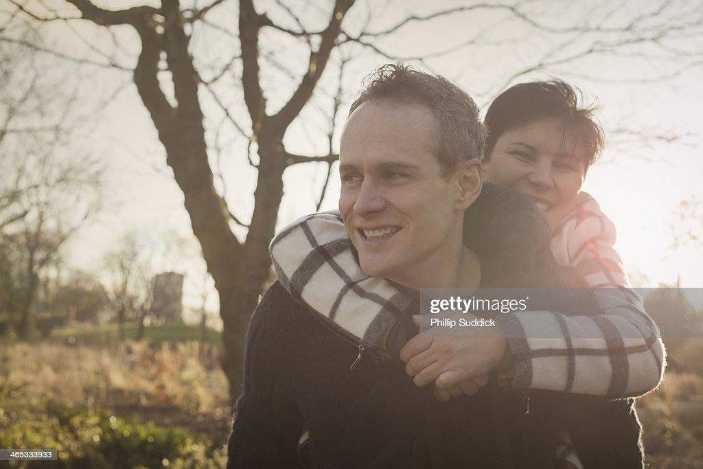 Happy professional couple on piggyback