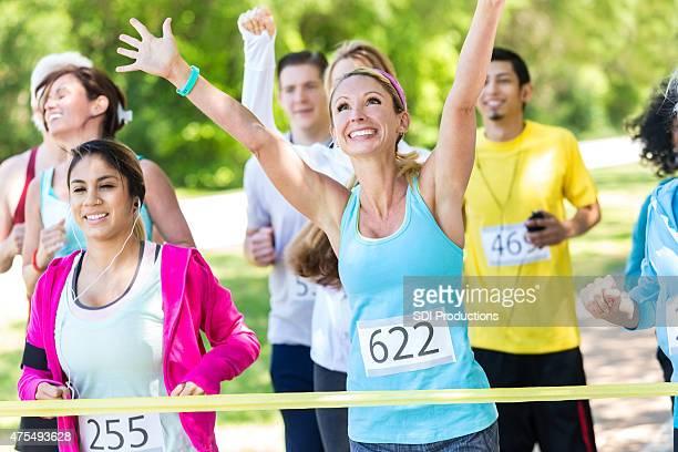 Happy runner winning marathon or charity race