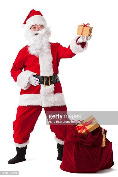 Happy Santa Claus handing out gifts