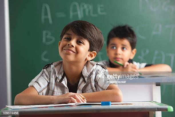 Happy schoolboy (6-7) smiling in classroom