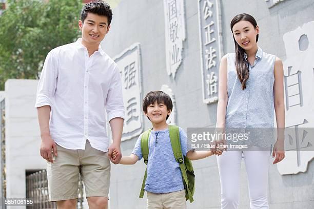 Happy schoolboy with his parents