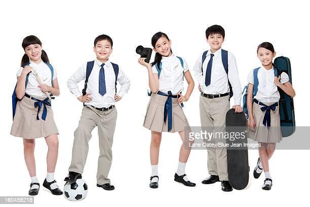 Happy schoolchildren and their leisure interests
