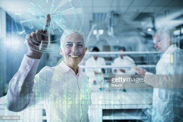 Happy scientist working on futuristic innovation on a touch screen.