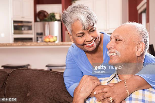 Happy senior adult couple at home.