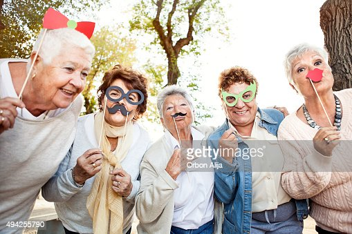 Happy senior adult women making faces