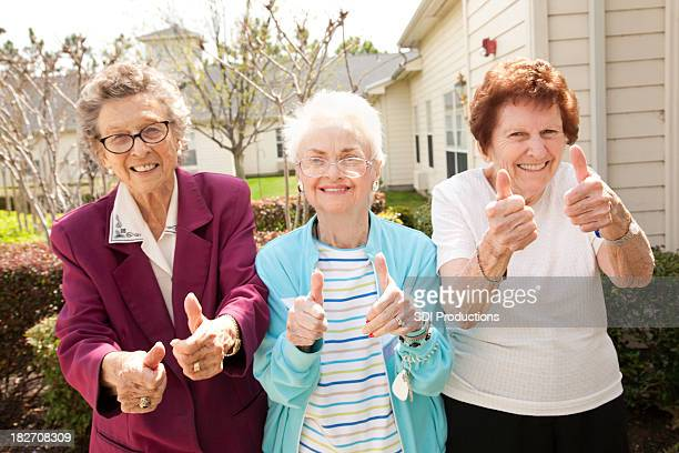 Happy Senior Adult Women With Their Thumbs Up