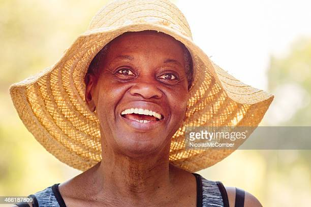 Happy senior African American woman in hat
