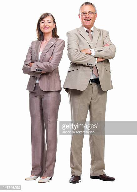Happy senior businessman and businesswoman standing against white background