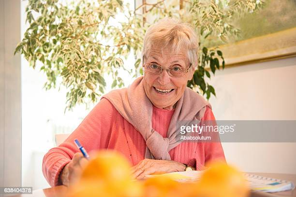 Happy Senior Caucasian Woman Studying at Home, Brac, Croatia