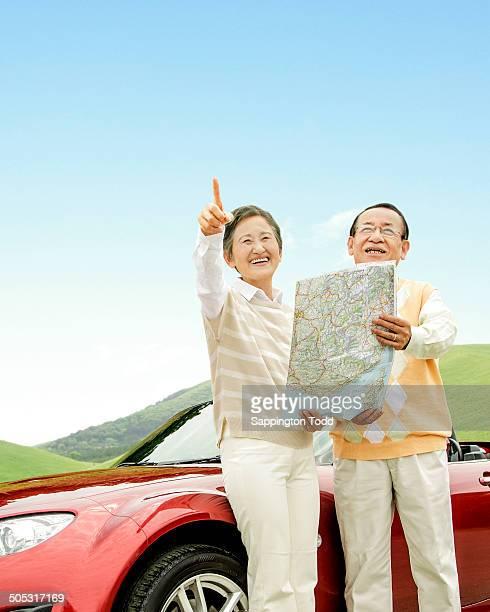 Happy Senior Couple Enjoying Car Ride
