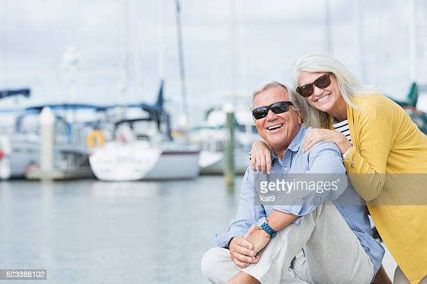 Happy senior couple enjoying harbor view