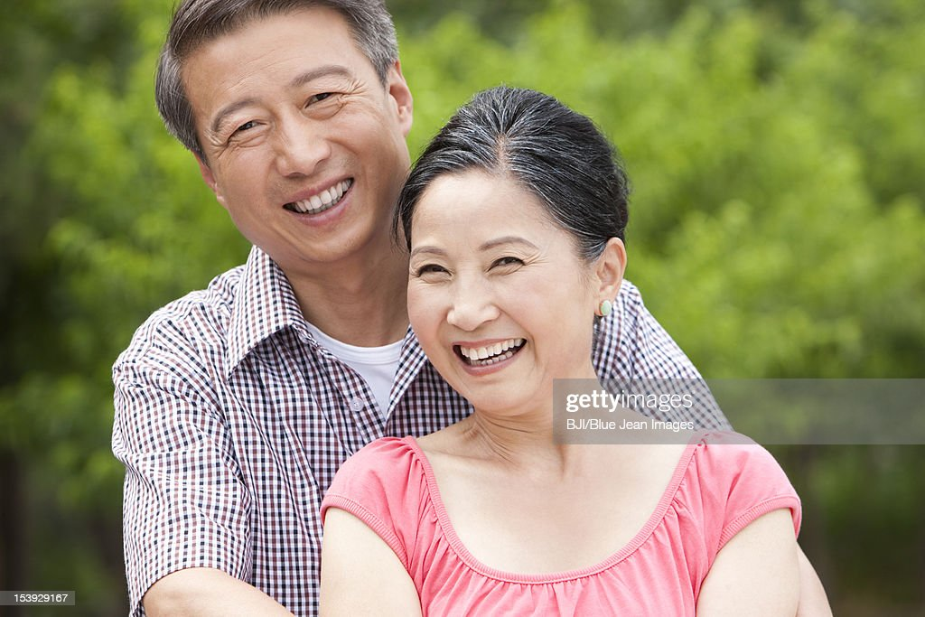 Happy senior couple in a park