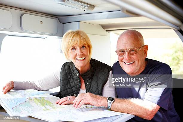 Happy senior couple planning for a roadtrip