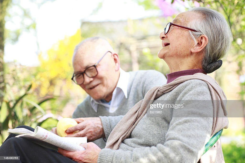 happy senior couple relax in the garden : Stock Photo
