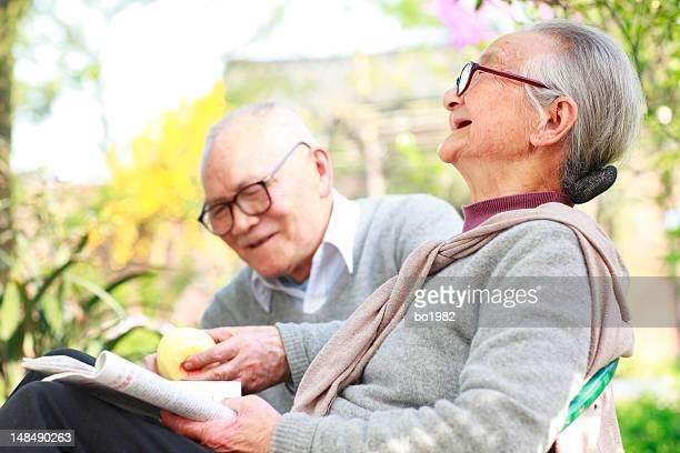 happy senior couple relax in the garden