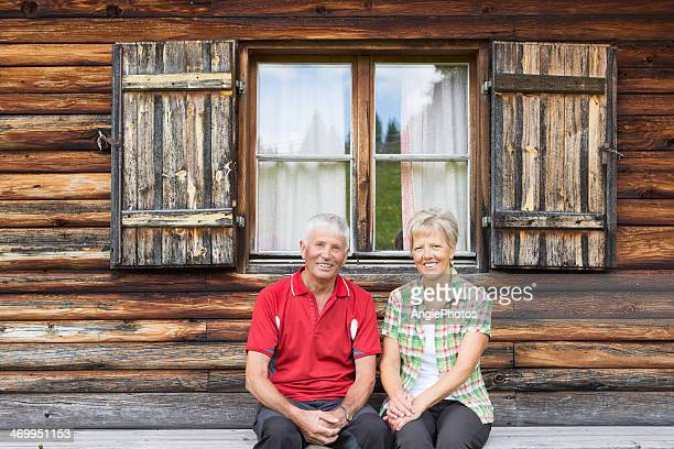 Happy senior couple relaxing in the mountains