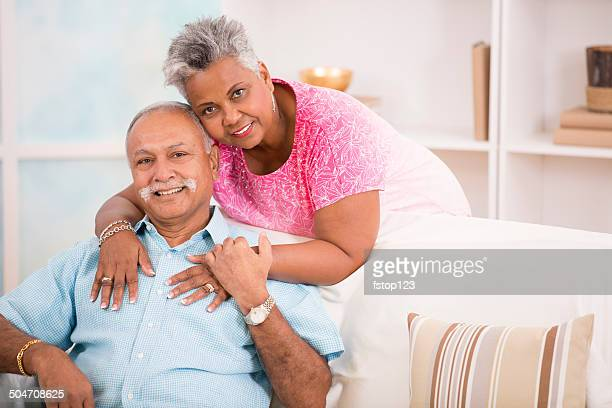 Happy senior couple share a hug. Home or assisted living.