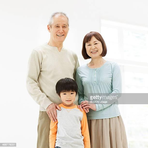 Happy Senior Couple With Their Grandson