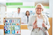 Happy senior customer in a pharmacy