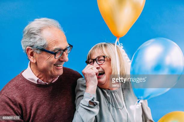 Happy Senior French Couple with Baloons