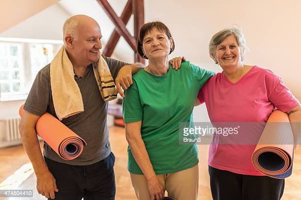 Happy senior friends ready for an exercise class.
