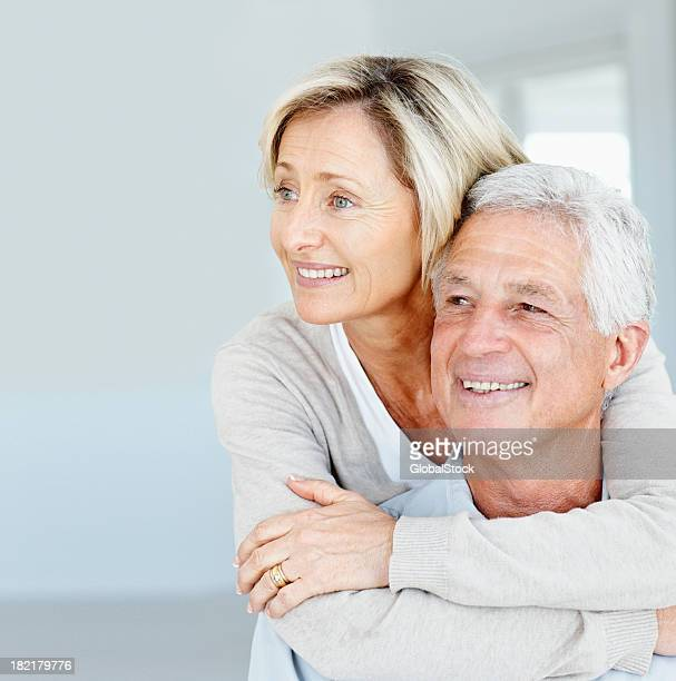 Happy senior lady embracing her husband