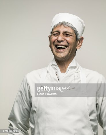 Happy senior male chef