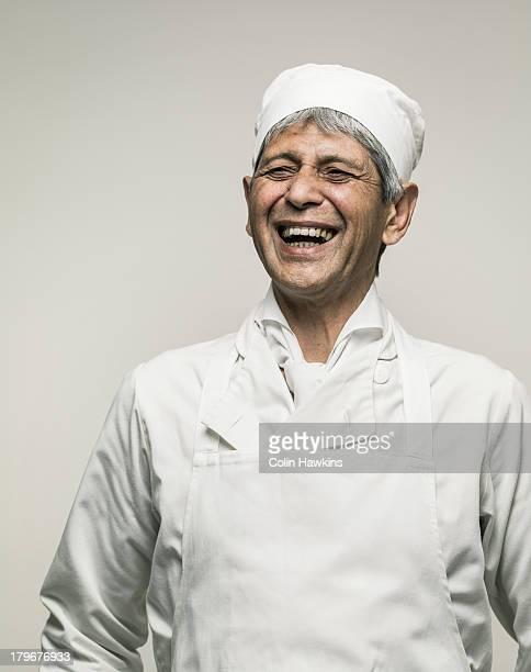 Happy senior male chef