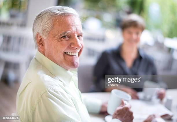 Happy senior man at a cafe
