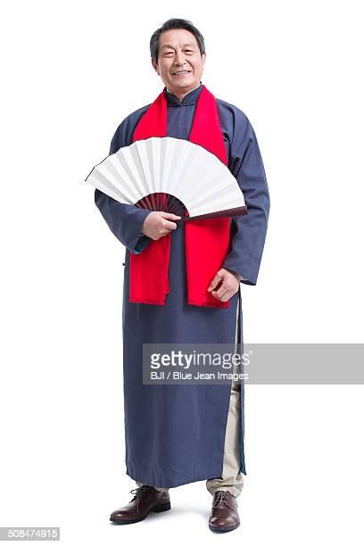 Happy senior man celebrating Chinese New Year