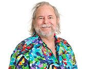 Happy Senior Man In Tropical Hawaiian Shirt