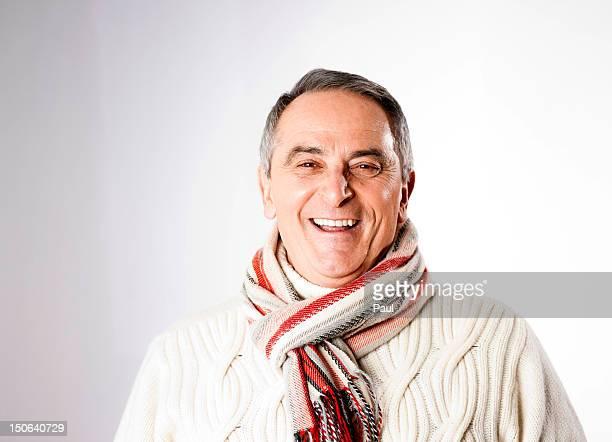 Happy senior man in winter clothes, portrait