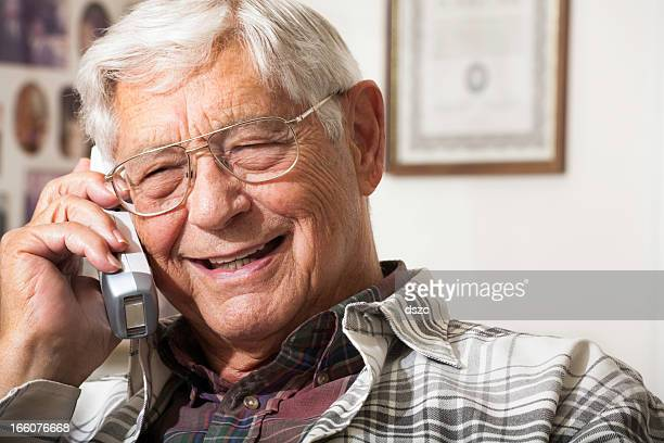 happy senior man talking on telephone