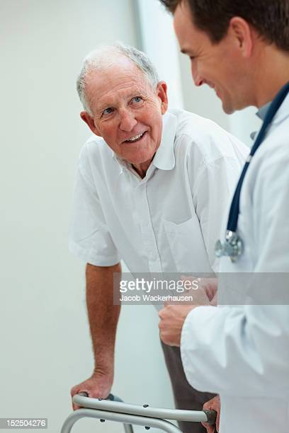 Happy senior man talking to a doctor